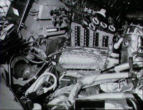 Astronaut L. Gordon Cooper Jr.,prime pilot for the Mercury-Atlas 9 mission, inside his Mercury spacecraft runs through one of the numerous pre-flight checks surrounded by dials, switches, indicators and buttons.