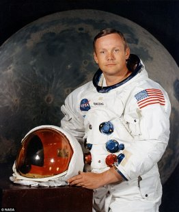 One giant leap for footwear: The sneakers feature blue and red fixtures which mimic those found on NASA spacesuits like the one worn by Neil Armstrong, the first man to walk on the moon (pictured)